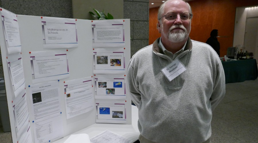 Man standing in front of poster presentation.